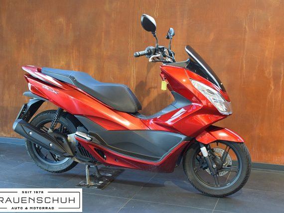 489029_1406472484489_slide bei Honda Frauenschuh Salzburg & Köstendorf / Auto & Motorrad in